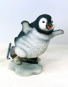 Fun skating penguin garden ornament
